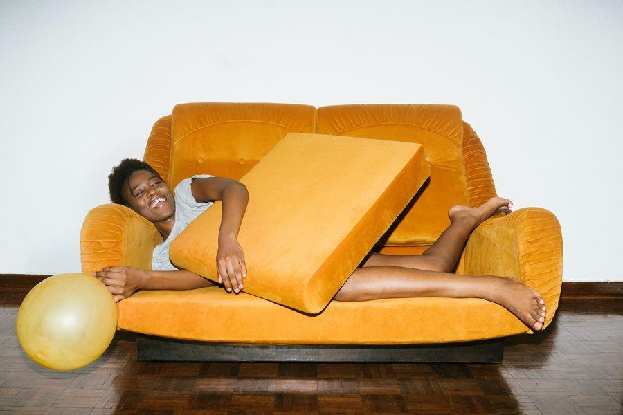sofa woman yellow