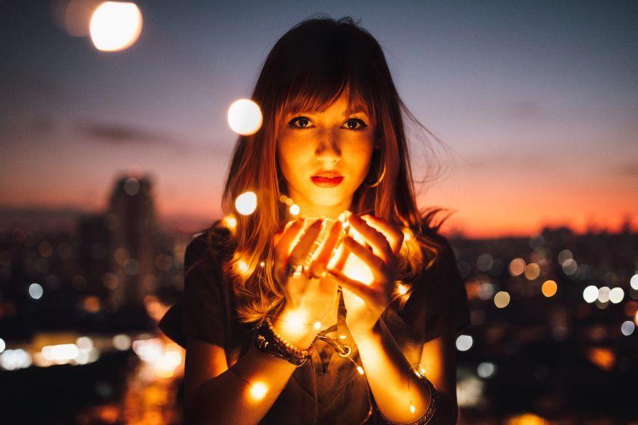 young-woman-balcony-lights