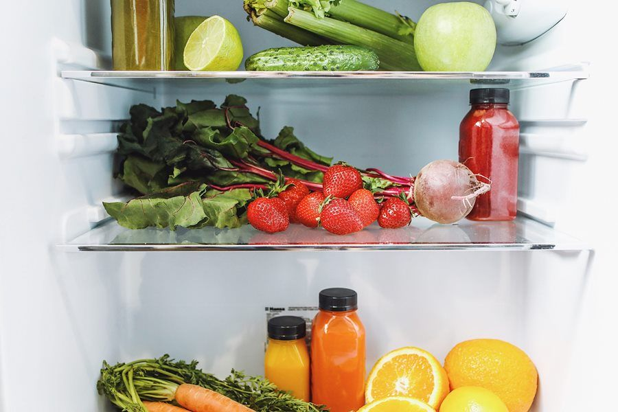 Assorted Fruits and Vegetables in Refrigerator