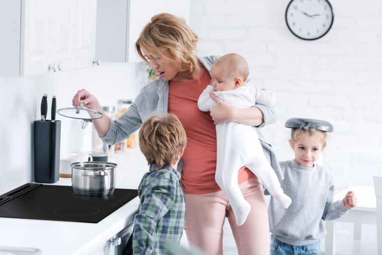 Woman with children in the kitchen